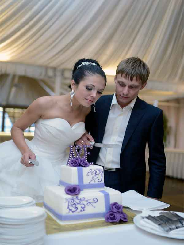Bride and Groom preparing to cut the wedding cake